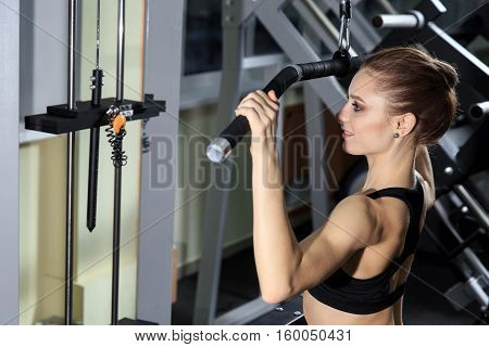 Young Woman Exercising Back On Machine In The Gym And Flexing Muscles - Muscular Athletic Bodybuilder Fitness Model