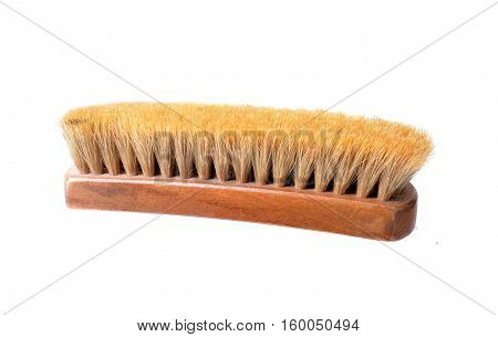 Close up shot of a bristle shoe brush on white
