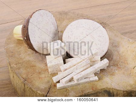 Closeup taro roots on wooden background. food