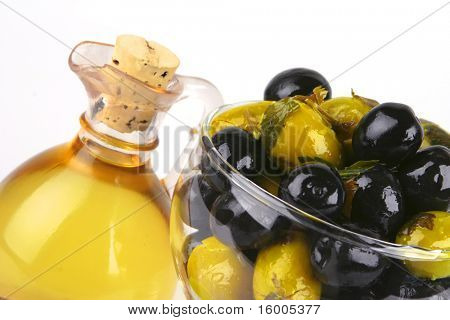 olive oil and olives over white background