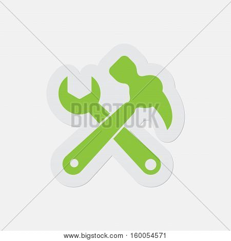 simple green icon with light gray contour and shadow - claw hammer with spanner on a white background