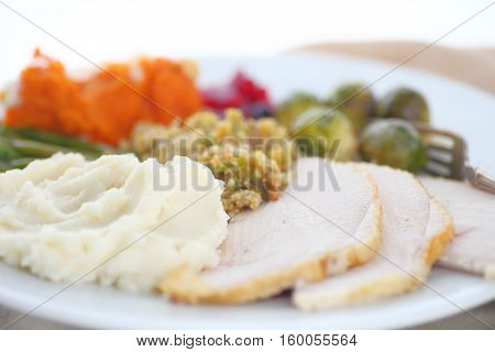 Turkey with stuffing mashed potatoes brussels sprouts sweet potatoes and cranberry sauce