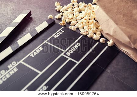 movie clapper with salty popcorn- time for movie