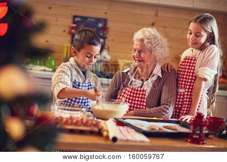 Baking xmas cookies with grandmother on Christmas time