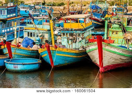 Fishing boats in Vietnam harbor all together