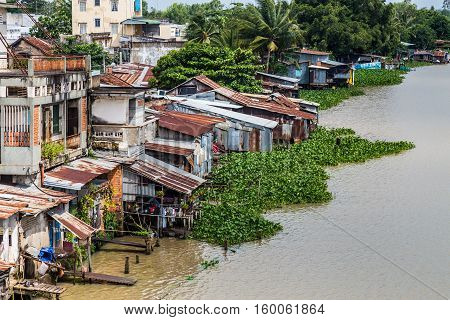 Vietnamese shanty town next to a river