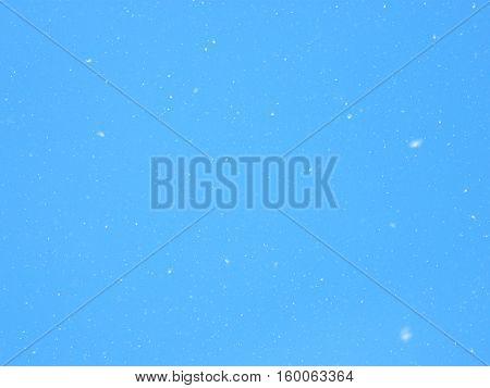 Poplar fluff on a background of the blue sky.