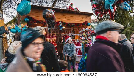 A Small Wooden Hut Or Are Sold Santa Hats And Balloons