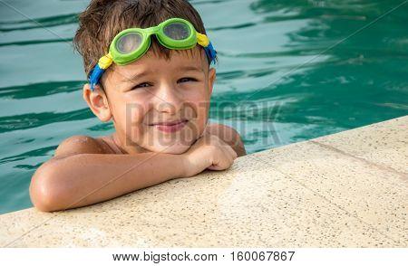 Pretty little boyl in swimming pool
