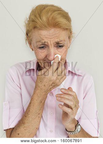 Senior Women Blowing Nose