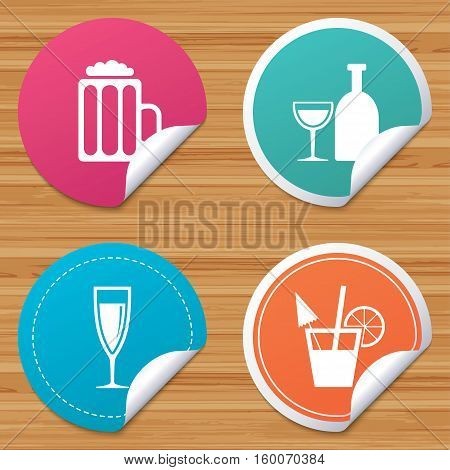 Round stickers or website banners. Alcoholic drinks icons. Champagne sparkling wine and beer symbols. Wine glass and cocktail signs. Circle badges with bended corner. Vector