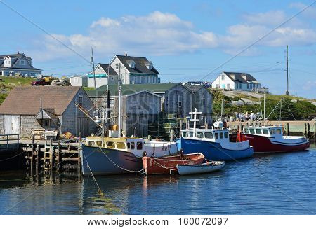 PEGGY'S COVE, NS. - AUGUST, 2016 : Fishing boats docked in the harbour at famous Peggy's Cove in Nova Scotia