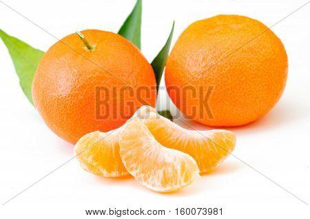 Mandarin citrus fruit on white background. Orange with leaf and peeled.