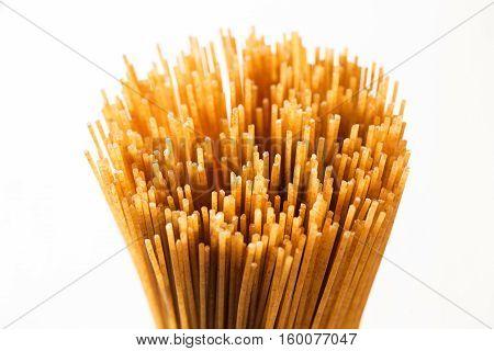 Yellow Long Spaghetti Integral On A Rustic Background. Yellow Italian Pasta.