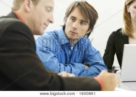 Three Businessworkers Sit And Talk