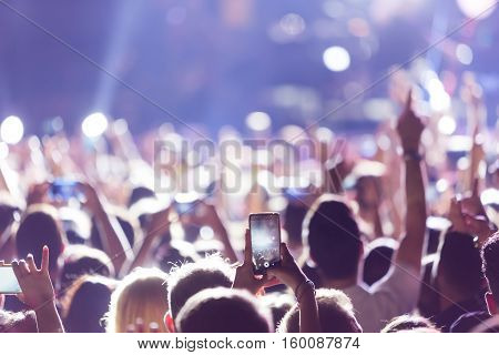 Hand With A Smartphone Records Live Music Festiva