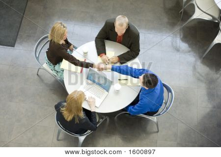 Business People Sit And Talk At A Table