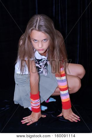 mischievous girl in a short skirt posing in studio