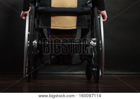 Disabled Person Sitting On Wheelchair.