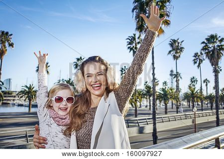 Smiling Mother And Child Tourists In Barcelona, Spain Rejoicing