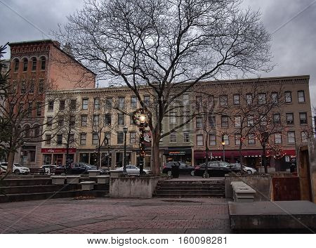 Syracuse New York USA. December 3 2016. View of the shop fronts and park in Hanover Square downtown Syracuse New York