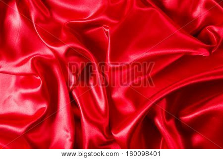 Sensuous Smooth shining Red Satin background topview