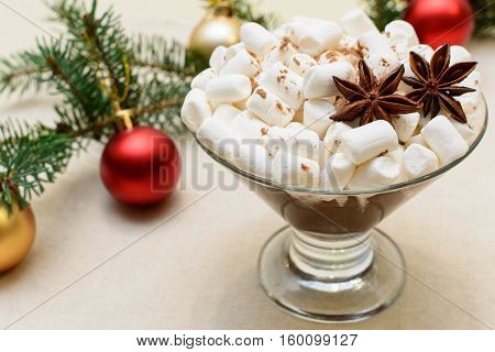 Christmas dessert with marshmallows and two stars of star anise