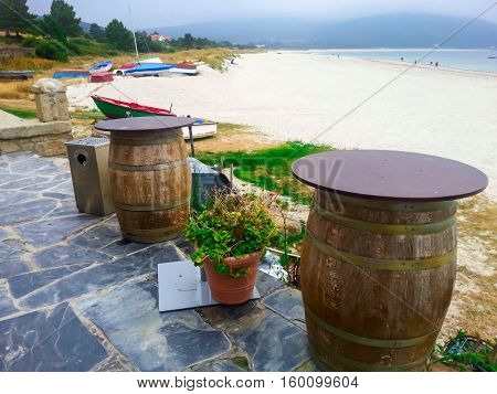 Beautiful landscape with colorful fishing boats and old barrels in Galicia, Spain