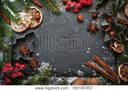 Christmas spices background. Holiday baking cooking ingredients. Christmas food. Top view with copy space.