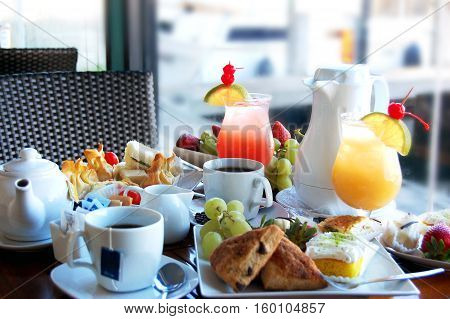 Afternoon tea with pastries, tea and juices