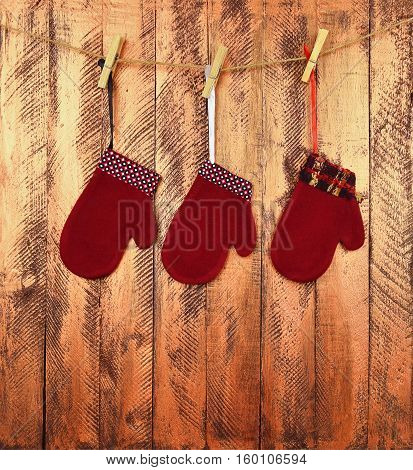 Decorative baby mittens on a bright wooden background. Waiting for a miracle. Traditions. Childhood. Christmas. New Year. Fairy tale./ Children's faith in miracles. /