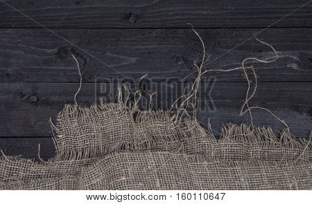 Burlap hessian or sacking on wooden background