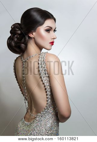 Portrait Beautiful Young Woman In An Evening Dress Crystal. Perfect Beauty, Red Lips, Bright Makeup.