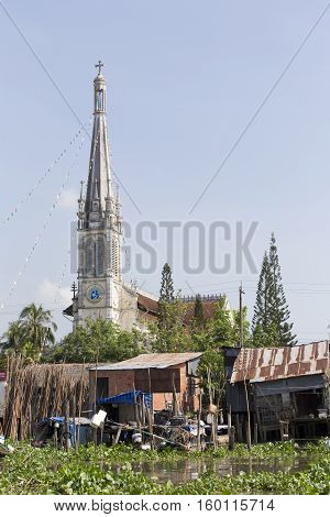 Town And Church Along The Mekong River
