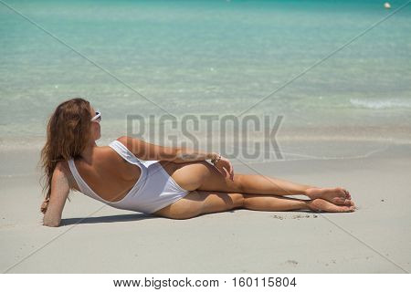 Model woman on the sandy beautiful beach