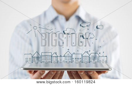 Hand of businessman demostrating tablet and construction concept on screen