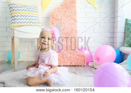 Portrait of one year-old baby girl indoors