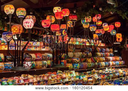 STUTTGART GERMANY - DECEMBER 3 2016: Colorful glass candle holders in a kiosk at Christmas market (Weihnachtsmarkt) on December 3 2016 in Stuttgart Germany.