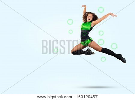 Young beautiful sporty cheerleader girl jumping high
