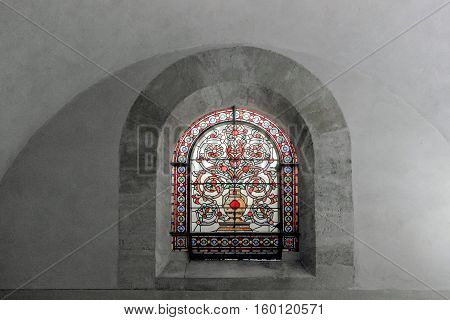 stained glass window on white wall in church