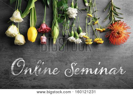 Text ONLINE SEMINAR with flowers on gray background. Florist and floral design tutorial concept.
