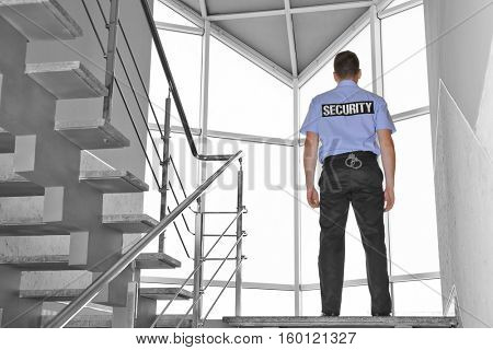 Security man standing on stairs