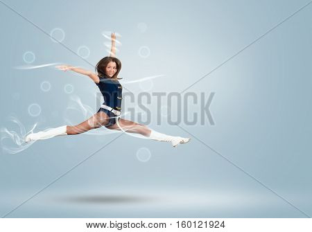 Young beautiful smiling cheerleader girl jumping high