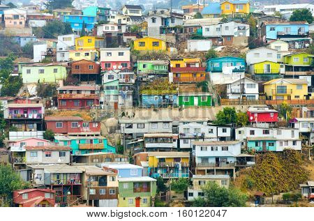 Brightly-colored houses tumble merrily down the sheer hills of Valparaiso Chile