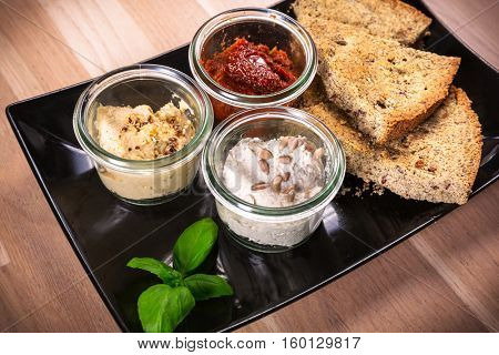 Hemp flour bread with dips and healthy collard juice