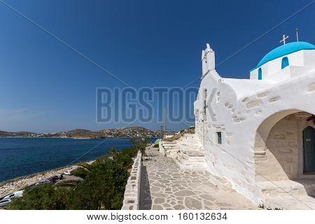 Amazing seascape with White chuch with blue roof in town of Parakia, Paros island, Cyclades, Greece