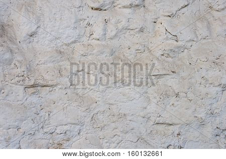 Close up of dusty rough white stone wall surface texture