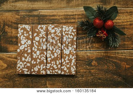 Delicious nougat typical sweet Christmas on a rustic wooden background