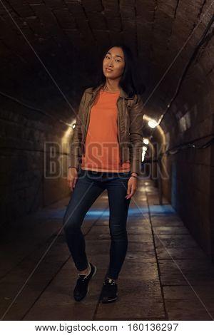 Woman in dungeon corridor