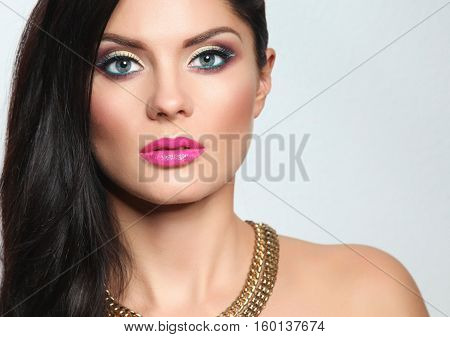 Portrait of beautiful woman, on grey background.